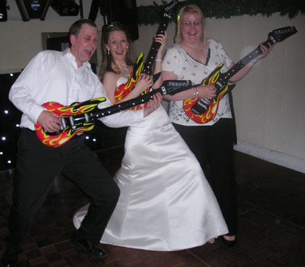 bride & guests play real air guitars!